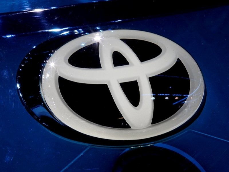 Toyota quarterly profit increases 14% on higher sales, cost cuts